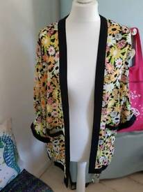 Ladies floral cover up jacket. Size Medium