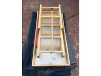 Insulated loft hatch with retractable wooden ladders