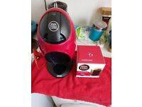Red dolce gusto machine with 16 pods