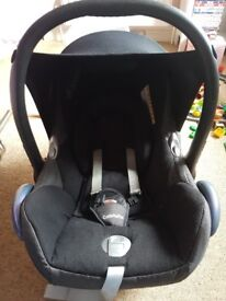 Maxi cosi car seat, raincover and bag.