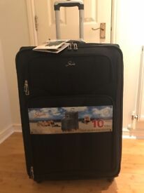 For Sale - Brand new luxury black expandable suitcase.