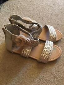 Girls gold sandles for sale, size 13 hardly used and in good condition