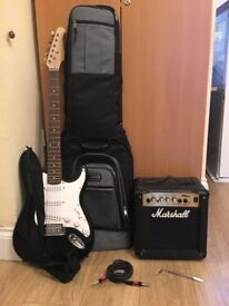 Electric Guitar with case amplifier and cable.