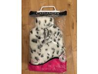 New in pack - fluffy white hot water bottle