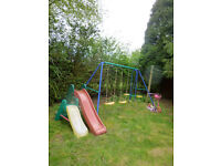triple swing unit and 2 slides and climbing frame slightyly worn for quick sale due to move