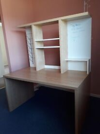 Desk with white board, magazine rack and built in shelving