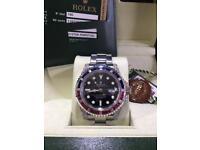 Rolex GMT II Diamond Ruby Sapphire P/X