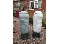 Molded plastic slimline garden water butts with stands but no attachments.