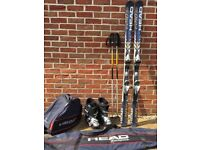 Ski boots, poles, skis and bags
