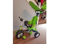 Green smart trike 4-1 baby/toddler