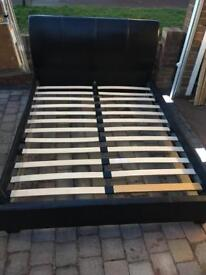 Brown leather king size bed with clean mattress