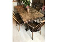 Antique oak dining table and 6 ercol Quaker Chairs