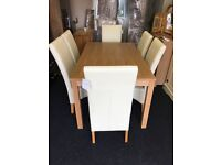 New 5ft fixed table with 6 cream leather chairs free delivery