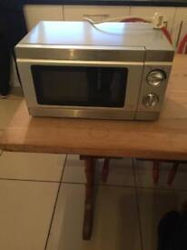 SMALL STAINLESS STEEL MICROWAVE OVEN EX CON AND FULL WORKING ORDER £15