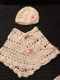 Knitted poncho and hat set in excellent condition.