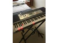Casio electric piano with stand and manual and power plug