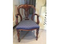 Smart mahogany armchair upholstered in blue