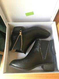 Black leather merino wool lined boots