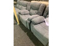 New grey fabric sofa and two recliner chairs