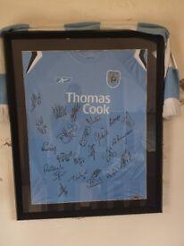 Framed signed Manchester City shirt