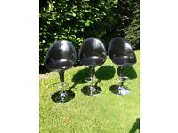 3 black Bombo style swivel chairs