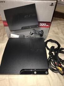 PlayStation 3 slimline inbox with leads
