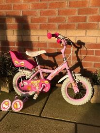 Girls First Bike with stabilisers