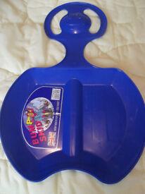 CHILD'S PLASTIC BUM SLEDGE