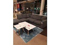 Grey corner sofa.