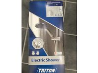 Triton electric shower 9.5kw in brushed steel