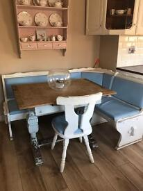 Farmhouse table and upholstered corner unit