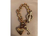 Gold juicy couture bracelet with heart and J pendant.