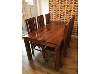 Dining table and chairs- Solid wood, seats 6-8 people.