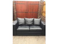 DFS Black leather 2 seater sofabed