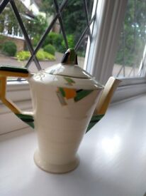 Grindley teapot, cream, green, orange and black design with gold ring on base and lid.
