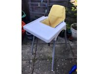 Ikea Antilop high chair with a tray and a cussion cover