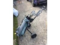 Lot of golf clubs, bag & trolley