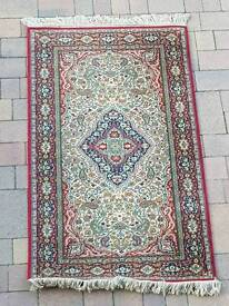 Gorgeous red blue and cream rug with tassels