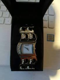 Seksy ladies Pearl dial stone watch
