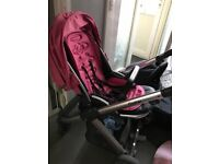 Pink oyster buggy with carrycot and accessories