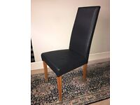 10 black leather covered dining chairs