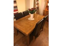 Solid oak extendable table plus 6 chairs