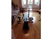 Weight bench with 35kg weights, barbell, fitness pump and stepper.