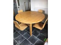 Extendable ikea dining table and four chairs