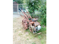 2 Vintage Trusty Tractors with lots of impliments for sale
