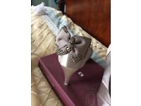 Silver Size 6 shoes with matching handbag.