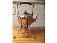 Tipping Teapot Silver