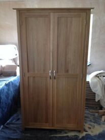 Light Oak double wardrobe, as new, excellent condition. 1003 mm wide x 1910 mm high x 550 mm deep