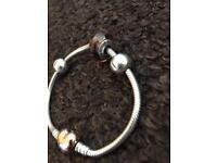 Pandora bracelet with rose gold clasp