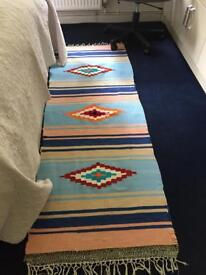 Hand woven multi colored long rug